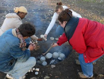 Students working with pottery