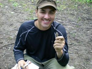 Student holding an arrowhead